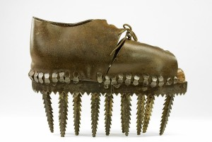 Apparently a shoe from France meant for crushing chestnuts. Image via batashoemuseum.ca